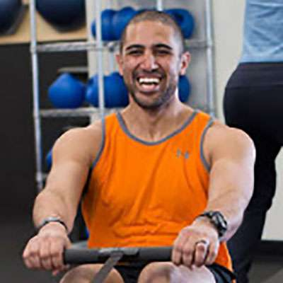 """trainer for Dr. Heus' RevInMo in California Martin Banda: """"I have been training since late 2010. I started at big corporate gyms and have worked my way in elite wellness and lifestyle based fitness companies. My main passion is Trainer development and education. With that my personal experience in fitness has been mainly in the strength training realm. I am a certified Strong First Elite Coach. That is I am proficient with kettlebell, barbell, and body weight respective strength training disciplines. My favorite part of RevInMo is the advanced method of nervous system recovery. With Revolution in Motion I have been able to survive and progress my rigorous strength training schedule. It has helped keep my mind and body fresh and injury free."""""""